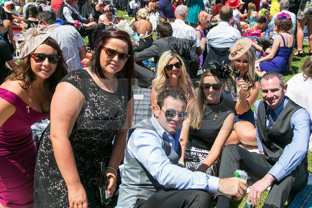 © Licensed to London News Pictures. 5/11/2013. Racegoers sitting on the lawn during Melbourne Cup Day at Flemington Racecourse on November 5, 2013 in Melbourne, Australia. Photo credit : Asanka Brendon Ratnayake/LNP