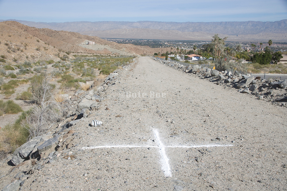 edge of rural and urban environment with new road in development used as an flood protection dam USA California