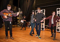 """Dan Pinkham-Breslin, Daniel Kehr, Cameron Doyle and Marissa Leyland rehearse a scene from """"A Fever Dream of Creativity"""" a student run improv and sketch show with the Players Comedy Club at Winnisquam Regional High School on Wednesday afternoon.  (Karen Bobotas/for the Laconia Daily Sun)"""