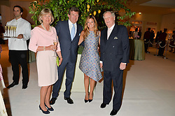 Left to right, the COUNTESS OF SUFFOLK, The HON.PEREGRINE HOOD, his wife SERENA and the EARL OF SUFFOLK at a dinner hosted by Cartier in celebration of The Chelsea Flower Show held at The Hurlingham Club, London on 19th May 2014.