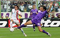 Firenze 01/10/2006<br /> Campionato Italiano Serie A 2006/07<br /> Fiorentina-Catania 3-0<br /> Luca Toni in scivolata su Fabio Caserta<br /> Foto Luca Pagliaricci Inside<br /> www.insidefoto.com