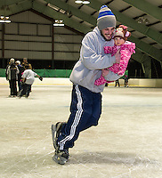 Brendan Labarre takes Abigail Lyman for her first skate Friday night during Gilford Parks and Recreation's skating party at the Arthur Tilton Ice Rink.  (Karen Bobotas/for the Laconia Daily Sun)