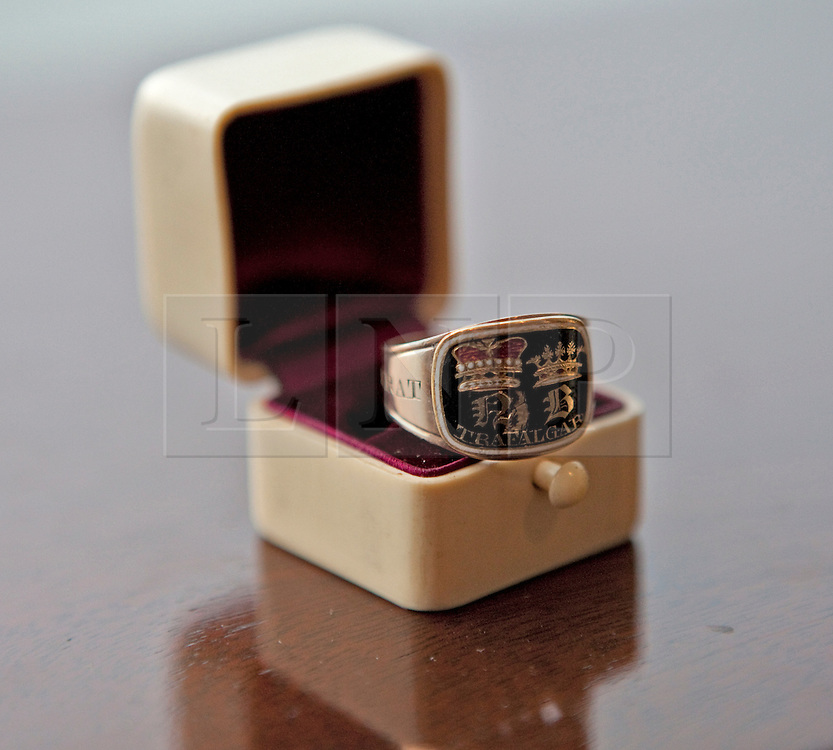 © Licensed to London News Pictures. 13/01/2012. London, U.K.A Nelson mourning ring, one of 58 made to commemorate the death of Lord Nelson, is displayed on January 13, 2012 in London, England. Bonhams Annual Gentlemans Library sale, which takes place today, is a collection of weird, wonderful and practical items from a range of historic periods.Photo credit : Rich Bowen/LNP