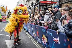 © Licensed to London News Pictures. 01/01/2019. London, UK. A Chinese Dragon dances for the crowd during the London New Year's Day Parade. More than 8,000 performers from 26 countries are taking part in the parade. Photo credit: Rob Pinney/LNP