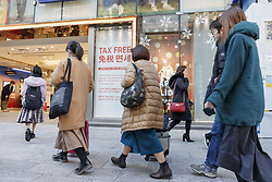 December 18, 2018 - Tokyo, Japan - Foreign tourists carrying their shopping bags walk along Chuo-dori (the main shopping street) in Ginza. This year the number of foreign tourists visiting Japan is expected to exceed 30 million for the first time ever, said on Friday, the Japanese tourist agency. The government has set a target to attract 40 million overseas tourists in 2020, the year of the Tokyo Olympic Games. (Credit Image: © Rodrigo Reyes Marin/ZUMA Wire)