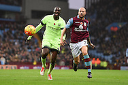 Yaya Toure  of Manchester city is challenged by Aston Villa 's Alan Hutton ®.   Barclays Premier league match, Aston Villa v Manchester city at Villa Park in Birmingham, Midlands  on Sunday 8th November 2015.<br /> pic by  Andrew Orchard, Andrew Orchard sports photography.