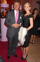 Actress MARGO STILLEY and ARNAUD BAMBERGER at a 'A Night in Cartier Paradise' to celebrate a new collection of jewellery by Cartier, held at The orangery, Kensington Palace, London W8 on 25th October 2005.<br />