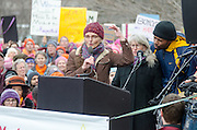 Augusta, Maine, USA. 21st Jan, 2017.  Jenny Van West, a singer-songwriter from Portland, Maine, leads a song at the Women's March on Maine rally in front of the Maine State Capitol. The March on Maine is a sister rally to the Women's March on Washington.