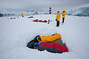 "People sleep in snow pits commonly referred to as ""snow coffins"" at dawn after spending the night on a small island in Leith Cove, Paradise Harbor, Antarctica Peninsula."