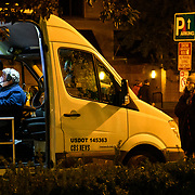 Two people watch the election coverage from a CBS News truck parked near Black Lives Matter Plaza in Washington DC, November 3, 2020.