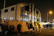 Police go past the burnout Archway metal works <br /> <br /> Europa League Group C- Tottenham vs Partizan Belgrade - White Hart Lane - England - 27th November 2014 - Picture David Klein/Sportimage