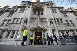 © Licensed to London News Pictures. 05/12/2016. London, UK. Policemen stand outside the Supreme Court in Westminster, London for the first day of a Supreme Court hearing to appeal against a November 3 High Court ruling that Article 50 cannot be triggered without a vote in Parliament. Photo credit: Peter Macdiarmid/LNP