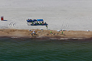 Arial view of close to empty beaches on a Sunday at Orange Beach Alabama due to oil on and off shore . Clean up crews hired by BP gather and clean the oil that is still gushing from the well ever since the Deepwater Horizon Rig on April 20, 2010, along the Alabama /Florida beaches but every day new tars balls wash up.