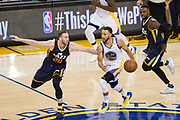 Golden State Warriors guard Stephen Curry (30) is fouled by Utah Jazz forward Gordon Hayward (20) at half court during Game 2 of the Western Conference Semifinals at Oracle Arena in Oakland, Calif., on May 4, 2017. (Stan Olszewski/Special to S.F. Examiner)