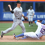 NEW YORK, NEW YORK - June 01:  Tyler Saladino #18 of the Chicago White Sox turns a double play as Juan Lagares #12 of the New York Mets slides in to second base during the Chicago White Sox  Vs New York Mets regular season MLB game at Citi Field on June 01, 2016 in New York City. (Photo by Tim Clayton/Corbis via Getty Images)