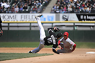 CHICAGO - APRIL 17:  Gordon Beckham #15 of the Chicago White Sox turns a double play after being upended by Peter Bourjos #25 of the Los Angeles Angels of Anaheim in the fifth inning on April 17, 2011 at U.S. Cellular Field in Chicago, Illinois.  The Angels defeated the White Sox 4-2.  (Photo by Ron Vesely)  Subject:  Gordon Beckham;Peter Bourjos