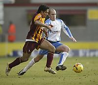 Photo: Aidan Ellis.<br /> Bradford City v Swindon Town. Coca Cola League 1. 11/02/2006.<br /> Swindon's Jack Smith challenges Bradford's Bobby Peta
