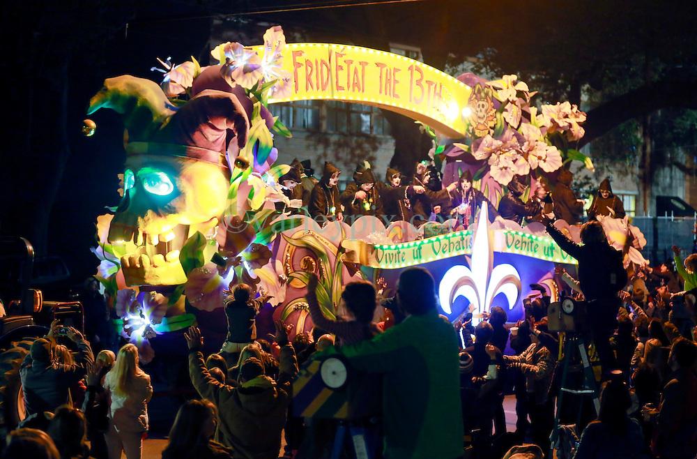 13 Feb 2015. New Orleans, Louisiana.<br /> Mardi Gras. Krewe D'Etat makes its way along Magazine Street. Frid'etat the 13th.<br /> Photo; Charlie Varley/varleypix.com