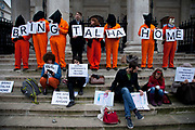 London, UK. Saturday 5th January 2013. Demonstrators in orange jumpsuits protest against the proposed extradition of Syed Talha Ahsan, a British citizen who has been held in custody in the UK since 2006. He was arrested in response to a request from the US under the UK Extradition Act 2003. He is the co-defendant with another British citizen Babar Ahmad, in a high profile case at the European Court of Human Rights. Both men are accused by the US of terrorism-related offences.