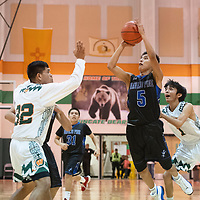 Navajo Pine's Galvin Curley (5) drives to the basket against Wingate at the Wingate Holiday Classic basketball tournament at Wingate High School Friday evening.