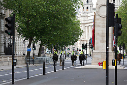 © Licensed to London News Pictures. 21/06/2020. London, UK. Mounted Police Officers guard a sterile zone on Whitehall during a Black Lives Matter protest in Central London .Protests have taken place across the United States and in cities around the world in response to the killing of George Floyd by police officers in Minneapolis on 25 May. Photo credit: George Cracknell Wright/LNP