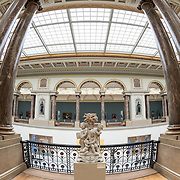 A side view of the main hall at the Royal Museums of Fine Arts in Belgium (in French, Musées royaux des Beaux-Arts de Belgique), one of the most famous museums in Belgium. The complex consists of several museums, including Ancient Art Museum (XV - XVII century), the Modern Art Museum (XIX ­ XX century), the Wiertz Museum, the Meunier Museum and the Museé Magritte Museum.