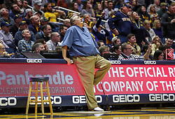Jan 21, 2019; Morgantown, WV, USA; West Virginia Mountaineers head coach Bob Huggins reacts to a call and watches the video replay during the second half against the Baylor Bears at WVU Coliseum. Mandatory Credit: Ben Queen-USA TODAY Sports