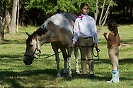 Middletown, New York - A girl stands with her horse before riding in the 70th annual Middletown Rotary Horse Show was at Fancher-Davidge Park on Sept. 8, 2013.