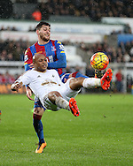 Andre Ayew of Swansea city tries an overhead shot at goal under pressure from Joel Ward of Crystal Palace.Barclays Premier league match, Swansea city v Crystal Palace at the Liberty Stadium in Swansea, South Wales on Saturday 6th February 2016.<br /> pic by Andrew Orchard, Andrew Orchard sports photography.