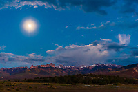 Moon rise (peaks of the Cimarron Range in background), Ridgway, Colorado USA.