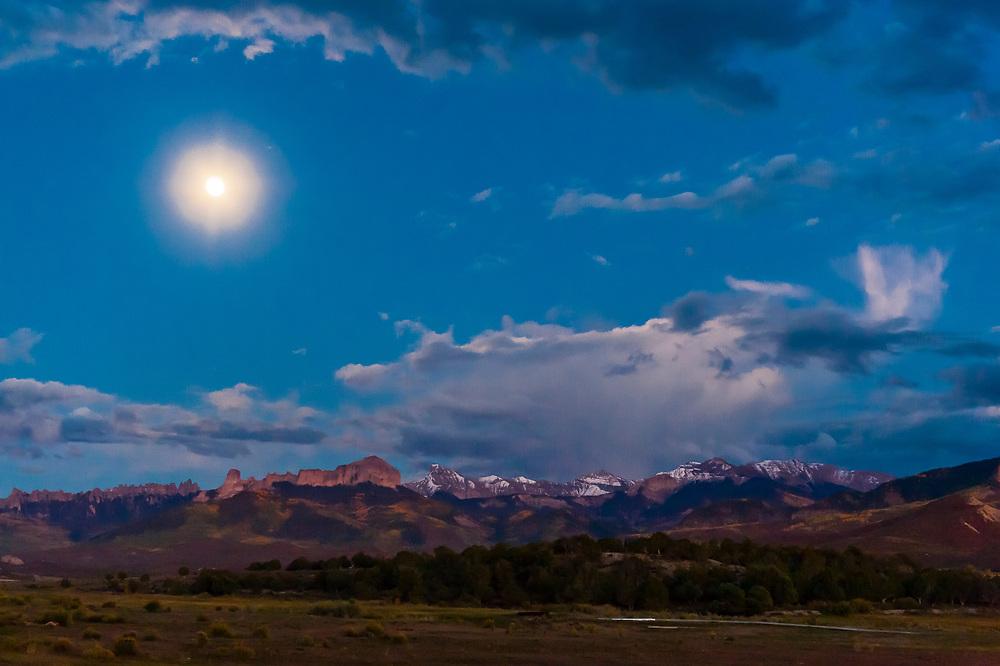 Moon rise (peaks of the Cimarron Range in background), Ridgway, Colorado USA.