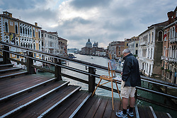 Painter on the Ponte dell Accademia over the Grand Canal looking towards the Basilica di Santa Maria della Salute in Venice, Italy.<br /> Photo: Ed Maynard<br /> 07976 239803<br /> www.edmaynard.com