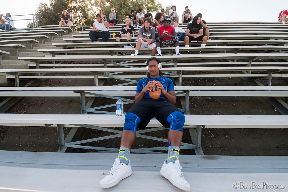 San Juan Spartans Tui Vaivai (7), sits in the stands during the JV game before they played the Mira Loma Matadors, Friday Sep 16, 2016.<br /> photo by Brian Baer