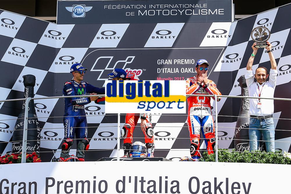 Ducati's Team rider Italian Andrea Dovizioso, winner, Maverick ViÒales of Spain  and Movistar Yamaha MotoGP second, Danilo Petrucci of Italy and OCTO Pramac Racing third during the Moto GP Grand Prix at the Mugello race track on June 4, 2017 celebrates on the podium. <br /> MotoGP Italy Grand Prix 2017 at Autodromo del Mugello, Florence, Italy on 4th June 2017. <br /> Photo by Danilo D'Auria.<br /> <br /> Danilo D'Auria/UK Sports Pics Ltd/Alterphotos
