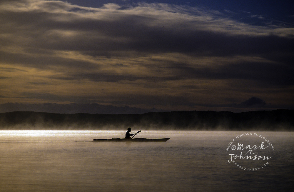 Australia, Queensland, Lake Cootharaba, kayaking in dawn mist ****Model Release available