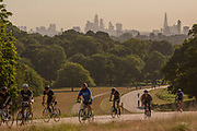 UNITED KINGDOM, London: 23 June 2020 <br /> Cyclists make their way through a busy Richmond Park, London in the early morning sun this morning. Temperatures are set to sore over the next few days reaching an expected 32 degrees Celsius in the capital on Thursday.