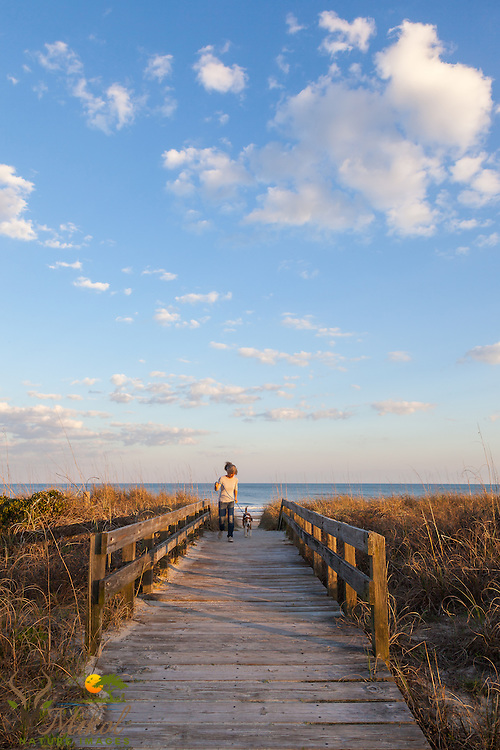 Woman with dog on Boardwalk, Myrtle Beach State Park