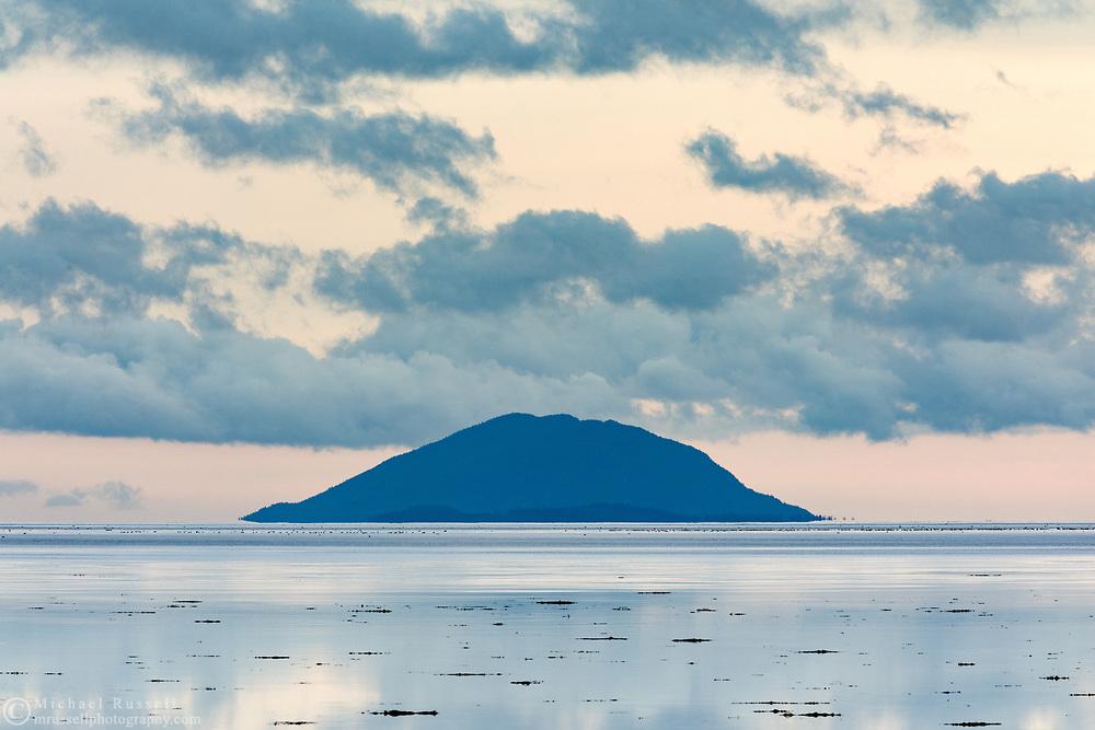 Lummi Peak on Lummi Island in Washington State USA. Photographed from Boundary Bay in British Columbia, Canada.