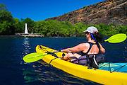 Kayaking on Kealakekua Bay at the Captain Cook monument, Kona Coast, Hawaii USA