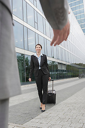 Businessman's hand greeting businesswoman at her arrival, Bavaria, Germany