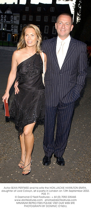 Actor SEAN PERTWEE and his wife the HON.JACKIE HAMILTON-SMITH, daughter of Lord Colwyn, at a party in London on 12th September 2002.	PDE 71