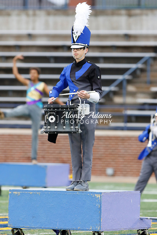 A member of the Sapulpa High School Marching Band performs during prelims of the Oklahoma Bandmasters Association 6A State Marching Band Championship at Wantland Stadium on the campus of the University of Central Oklahoma in Edmond, Okla. on Saturday, Oct. 31, 2015. (Photo by Alonzo J. Adams for the Tulsa World).