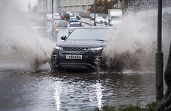 © Licensed to London News Pictures. 03/10/2020. London, UK.  Traffic ploughs through surface flood water on the A4 eastbound at Hammersmith, west London, as Storm Alex brings heavy rain to large parts of the UK. Photo credit: Ben Cawthra/LNP