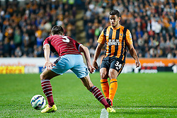 Hatem Ben Arfa of Hull City, making his club debut, is challenged by Aaron Cresswell of West Ham - Photo mandatory by-line: Rogan Thomson/JMP - 07966 386802 - 15/09/2014 - SPORT - FOOTBALL - KC Stadium, Hull - Hull City v West Ham United - Barclays Premier League.