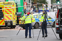 © Licensed to London News Pictures. 15/08/2018. London, UK. Police carry evidence gathering equipment at the scene of an accident at Holborn where a cyclist has died after being hit by a lorry - believed to be former doctor to the Queen Peter Fisher. Photo credit: Rob Pinney/LNP