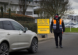 © Licensed to London News Pictures. 11/01/2021. Epsom, UK. Drivers are being redirected to an overflow car park at the vaccination centre at Epsom Racecourse in Surrey. The Epsom site is one of the new UK mass vaccination hubs with thousands of the Oxford AstraZenica jab expected to be given out everyday. Photo credit: Peter Macdiarmid/LNP