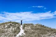 Woman affirms the new day, Dennis, Cape Cod, Massachusetts, USA