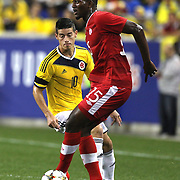 Doneil Henry, Canada, in action during the Colombia Vs Canada friendly international football match at Red Bull Arena, Harrison, New Jersey. USA. 14th October 2014. Photo Tim Clayton