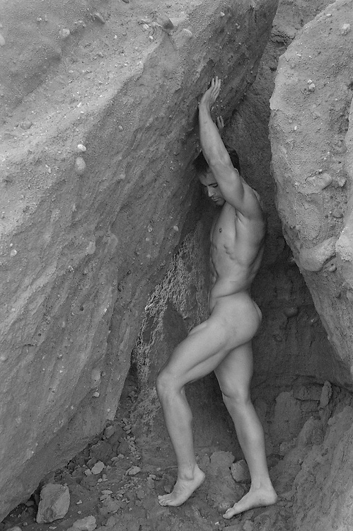 naked man and rock formation in Montauk, NY