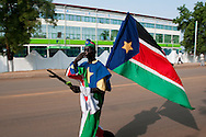 Southern Sudanese begin celebrating in the streets of the capital on the day before South Sudan declares independence from the North..Juba, South Sudan. 08/07/2011..Photo © J.B. Russell